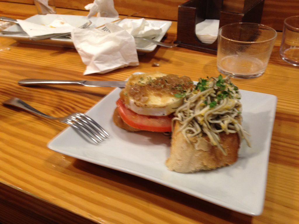 Pinchos - left: tomato & goat cheese, right: gulas (eels) with garlic