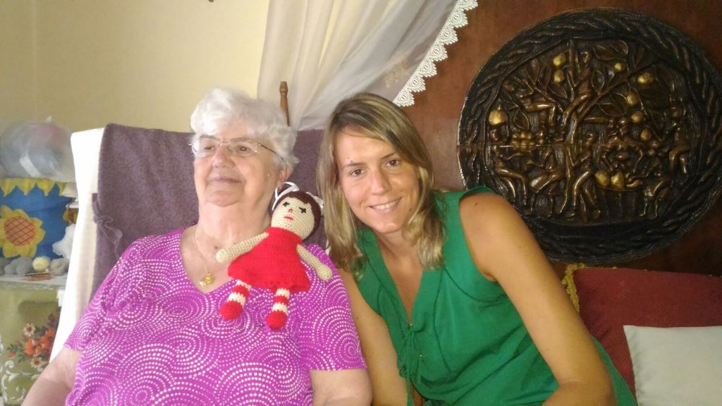 Maria and her grandmother with the doll grandmother made