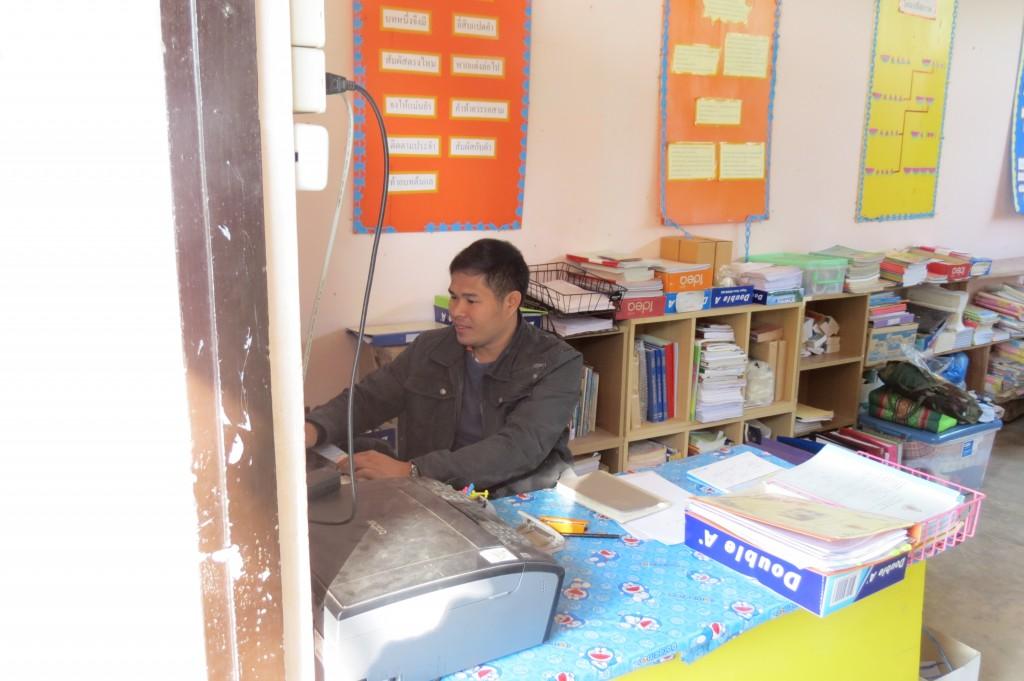 Jason Nontakan at his desk in his Classroom