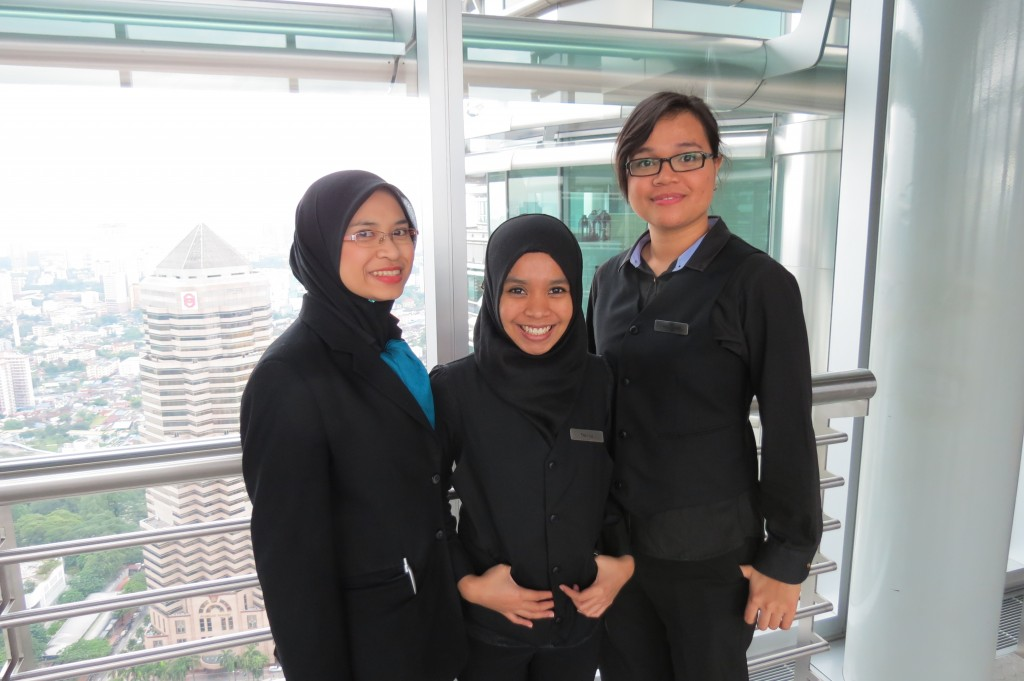 Lovely Young Ladies Ushering Us Through Our Petronas Towers Bridge Tour