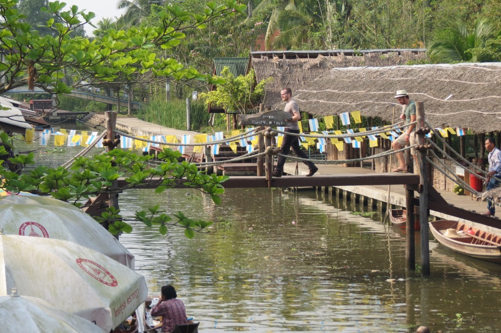 Michael crossing bridge at Tha Kla Floating Market